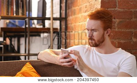 Relax Man Using Smartphone, Sitting On Sofa