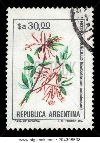 ARGENTINA - CIRCA 1984: a stamp printed in the Argentina shows embothrium coccineum, known as the chilean firetree, chilean firebush, is a small evergreen tree in the flowering plant family Proteaceae, series, circa 1984