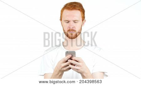 Red Hair Man Using Mobile Smart Phone, Typing Message On White Background
