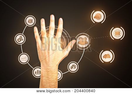 Male hand on dark background with creative business interface diagram. Innovation concept
