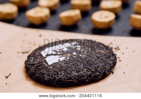 Selective focus on Tea cake traditional chinese puer drink in different forms and the sorts. Popular antioxidant from China.