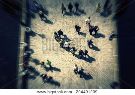 Top view crowd on bridge with unrecognizable faces. City commuters.