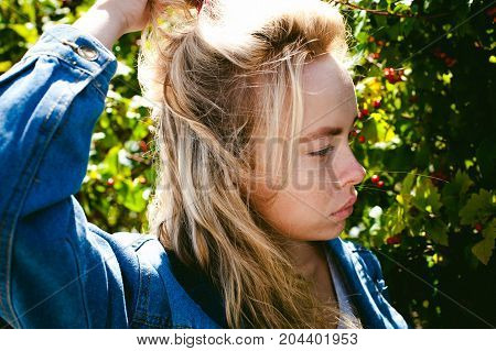 Young Beautiful Woman In Jeans Clothes Outdoors. Portrait Of A Girl With Freckles On Her Face, Styli