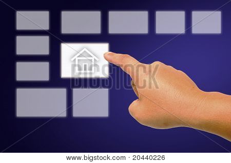Hand Pushing The Button House