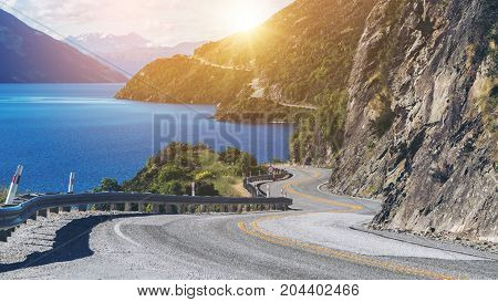 Winding Road Along Mountain Cliff And Lake