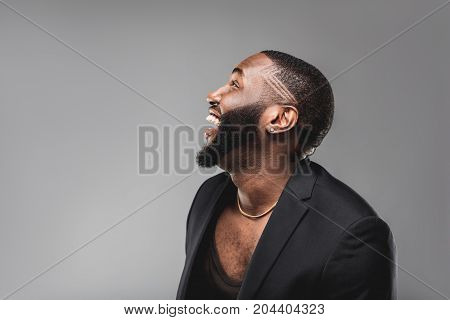 Cheerful Successful Young  African American Man Studio Portrait In Full Suit