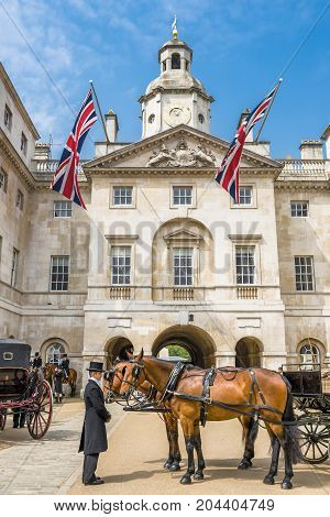 London - May 2016: horseman with the cart and the horses in the yard of Whitehall