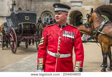 London, the UK - May 2016: royal guard in the yard of Whitehall