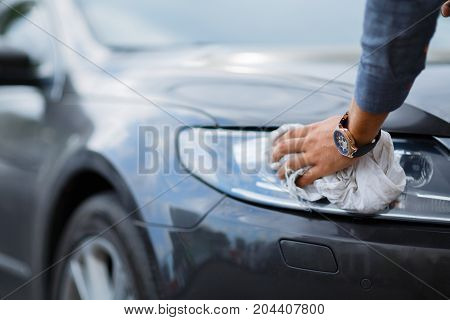 Buying used car. Cleaning. Cars For Sale Stock Lot Row. Car Dealer Inventory. Used cars store. Male wants to buy the car.