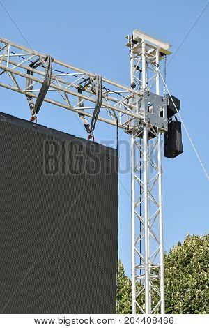 Baluster of a large LED screen outdoors against sky