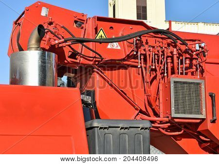 Part of a crane vehicle outdoor in summer