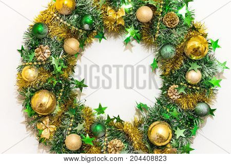 Christmas wreath of tinsel bows balls beads cones and stars