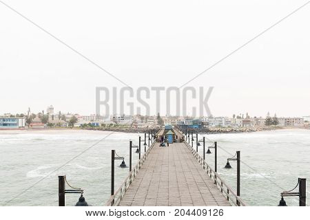 SWAKOPMUND NAMIBIA - JUNE 30 2017: A misty view of Swakopmund in the Namib Desert on the Atlantic Coast of Namibia as seen from the historic jetty