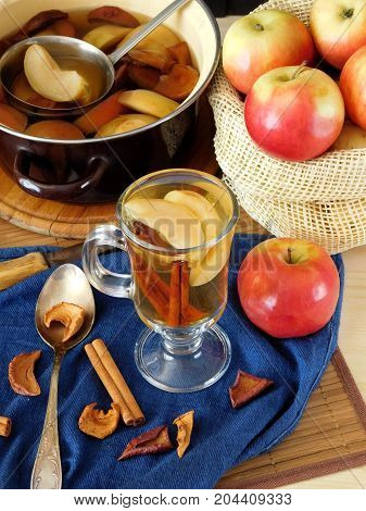 Spicy apple compote in an Irish mug with slices of apple and sticks of cinnamon