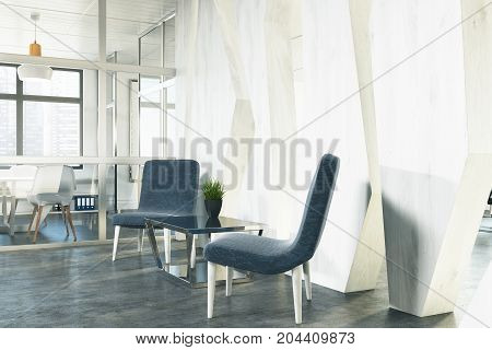 Side view of two stylish blue armchairs are standing near a coffee table in an office waiting area. An open space room is in the background. 3d rendering mock up