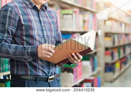 Hand Student Holding Book And Library Background.