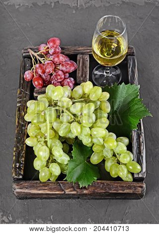 .healthy Food. Close-up View Bunch Of Grape With Glass Of Wine In Vintage Wooden Box