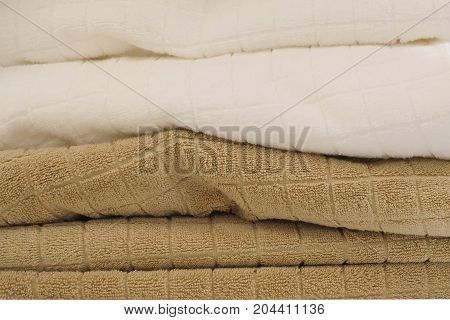 Hygiene Concept Stack of White and Brown Terry or Cotton Bath Towels Used for Drying or Wiping A Body.