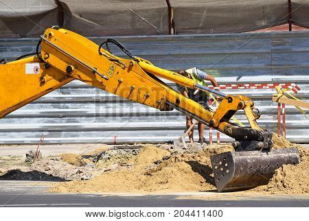 Loader of the excavator machinery at the road construction