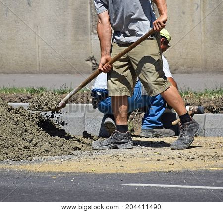 Men are working at the road construction