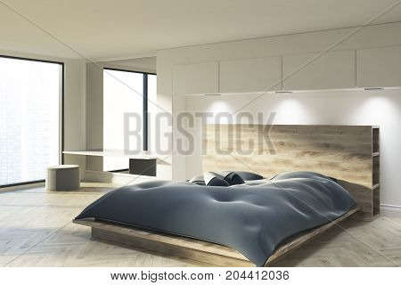 White Bedroom With A Blue Bed