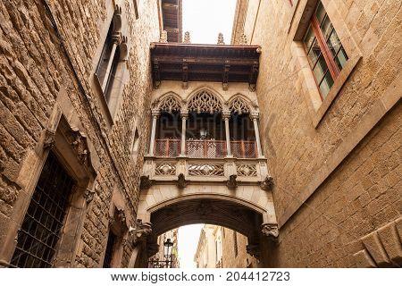 Famous bridge between buildings in Barri Gothic Quarter Barcelona , Catalonia, Spain