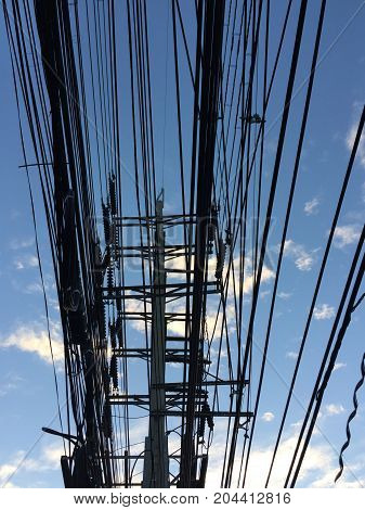 cable and electric cable on electric pole with blue sky background