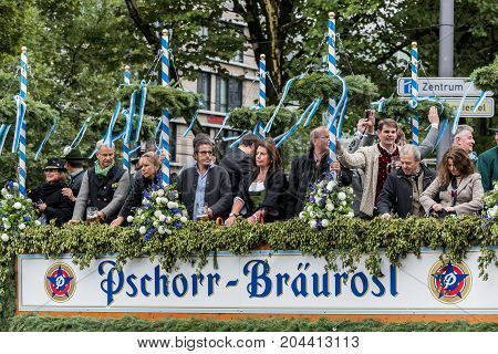 MUNICH, GERMANY - 16 OCTOBER 2017: Tent owners and breweries parade at the beginning of Oktoberfest - Hacker Pschorr parade