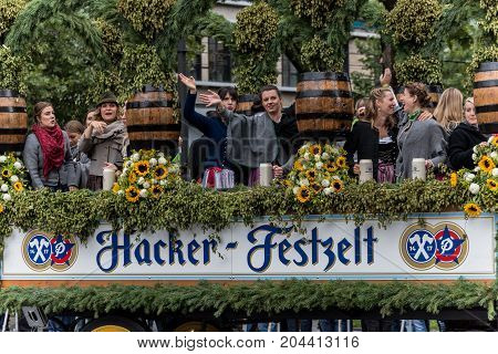 MUNICH GERMANY - 16 OCTOBER 2017: Tent owners and breweries parade at the beginning of Oktoberfest - Hacker Pschorr parade