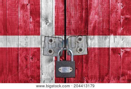 Denmark flag on door with padlock close