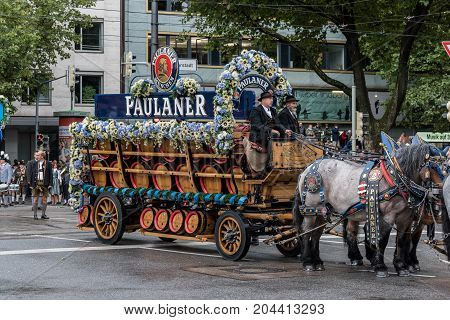 MUNICH GERMANY - 16 OCTOBER 2017: Beer wagon from Paulaner in tent owners and breweries parade at the beginning of Oktoberfest