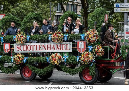 MUNICH GERMANY - 16 OCTOBER 2017: Tent owners and breweries parade at the beginning of Oktoberfest - Schottenhamel tent parade