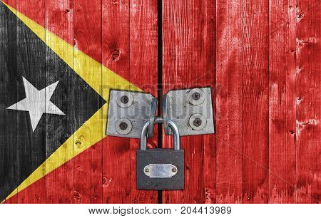 East Timor flag on door with padlock close