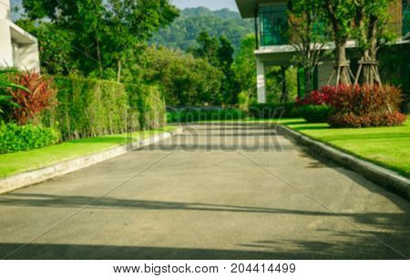 Blurred View of nice modern house in winter environment, road  with a yard on either side of a garden design,Landscape official.