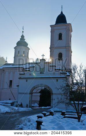 Monastery Beocin covered with snow at sunny winter morning, near Novi Sad, Serbia