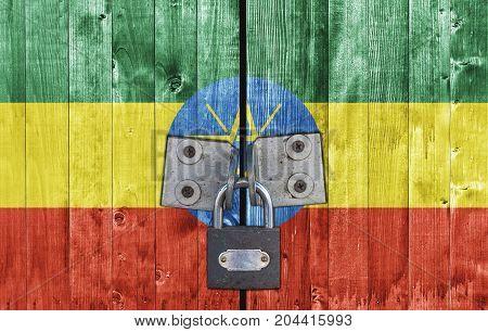 Ethiopia flag on door with padlock close