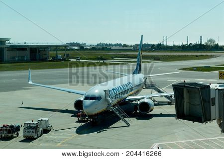 April 5th, 2017, Sa Carneiro airport, Porto, Portugal - Ryanair airplane parked near the boarding gates