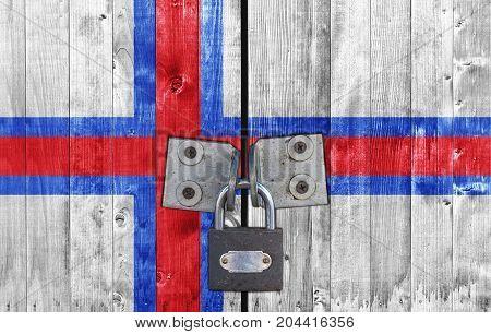 Faroe Islands flag on door with padlock