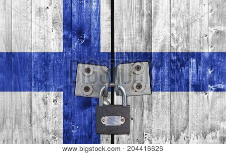 Finland flag on door with padlock close