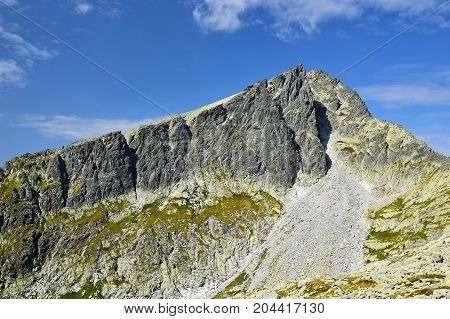 High Tatras in Slovakia. Monumental peaks. Summer scenic landscape mountain view. Alpine trail. Javorovy peak in Big cold valley.