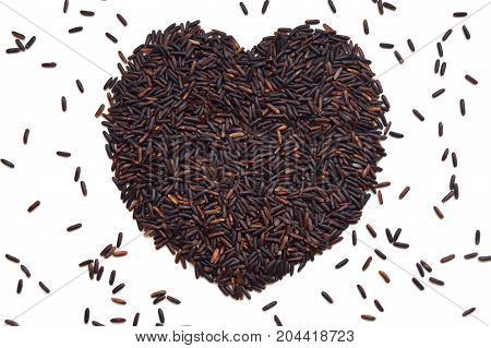 Riceberry seed heart shape on white background