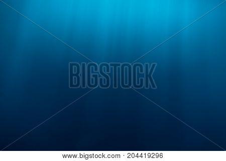 Water texture underwater and sun rays. Blue ocean in underwater