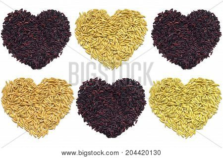 Riceberry and paddy rice heart shape on white background