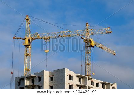 tower crane for construction of high-rise building in Sunny summer day
