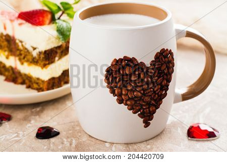 Valentines day cappuccino coffee and slice of carrot cake