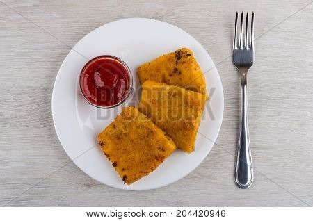 Pieces Of Fish In Breadcrumbs, Ketchup On White Plate