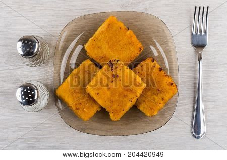 Pieces Of Fish In Breadcrumbs On Plate, Salt, Pepper