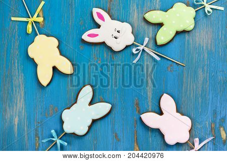 Easter bunnies. Gingerbread easter cookies in shape of bunny. Spring background. Space for text