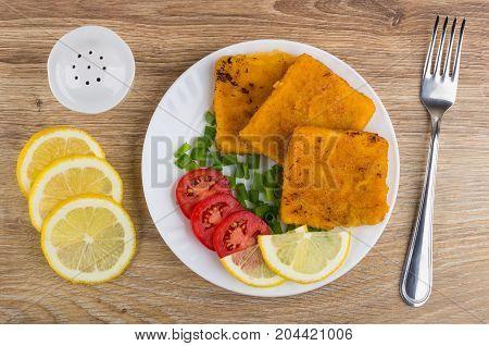 Fish In Breadcrumbs, Tomatoes, Scallion, Lemon On Plate, Salt