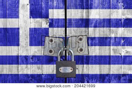 Greece flag on door with padlock close